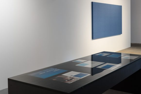 Foreground: Jeroen de Rijke / Willem de Rooij, <i>Blue Table</i>, 2004, Courtesy the artist; Background: Willem de Rooij, <i>Blue to Blue</i>, 2012; installation view KW Institute for Contemporary Art, 2017, Photo: Frank Sperling