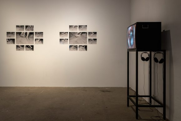 Back left: Anna Daučíková, <i>Untitled I</i>, 1993–94, 9 b/w-photographs; back right: <i>Untitled II</i>, 1993–94, 9 b/w-photographs; front: Anna Daučíková, <i>Queen's Finger</i>, 1998, SD video; installation view of the exhibition, KW Institute for Contemporary Art, Berlin, 2019, photo: Frank Sperling