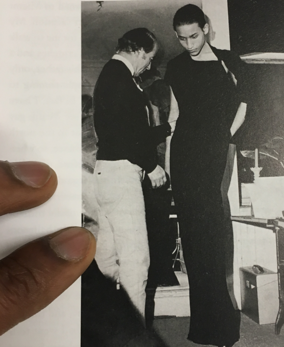"<p class=""_3vFF3xH4Yd"" dir=""ltr"" data-test=""textbox"">Jimmy Robert, 2018, research still, Charles James adjusting a black crepe gown on Juan Fernandez, photo by Bill Cunningham in: Douglas Crimp, <em>Before Pictures</em>, 2016</p>"